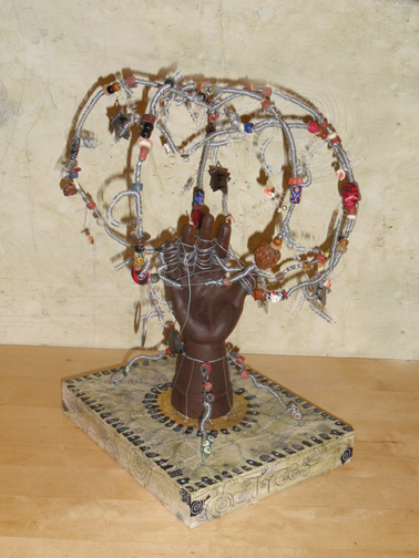My Trees Talking Sculpture; iron hand with wire weave and decorated;  on 8x10